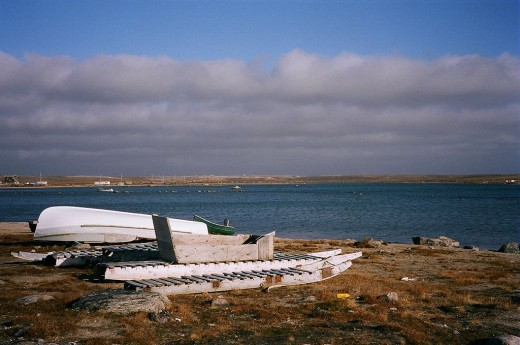 Komatiks or Qamutiqs beside the Clyde River, Baffin Island. These are larger sturdy sleds for transporting people and goods.