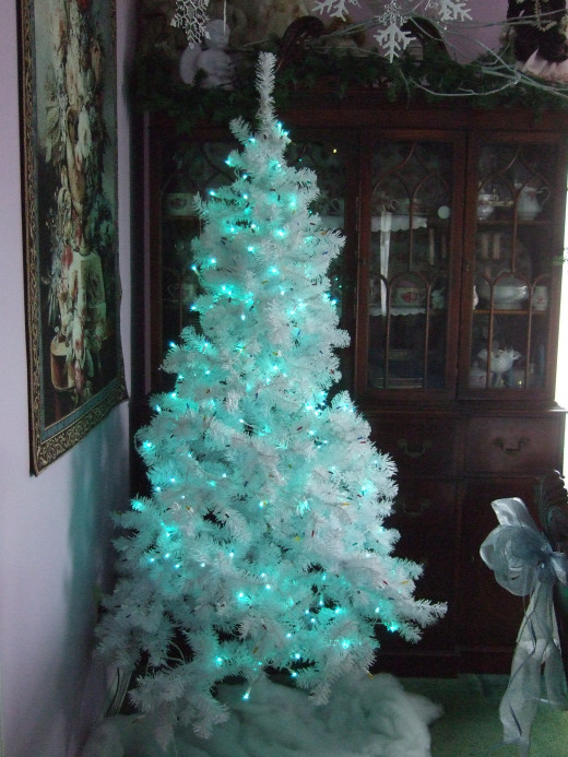 How the tree looks with the lights off, but still daylight outside. I really like it! Wait till you see all of the room later...