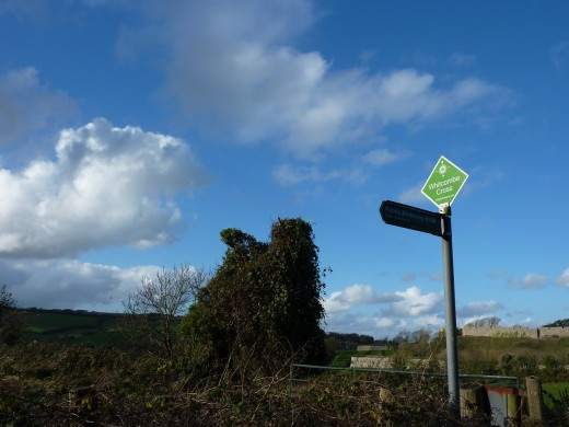 Here you can see the Whitcombe cross signpost. To the right of the post is the castle in the distance. The distant ridge off to the left of the post is the Tennyson trail, which will be your route back into Newport.