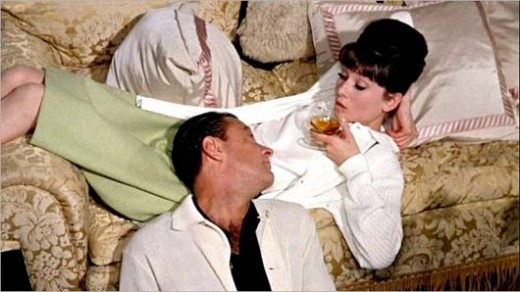 Hepburn with on and off screen love William Holden in Paris When it Sizzles (1964).