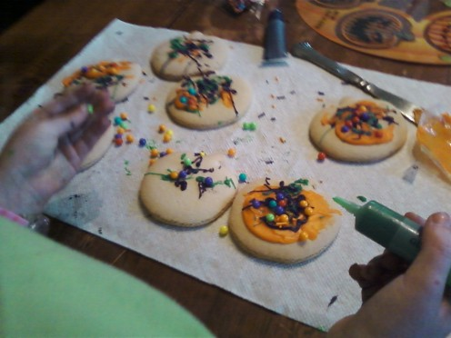5) Trying not to get your hands too dirty, add the finishing touches to your cookies.