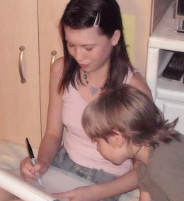 My younger brother watching me draw right before we all got MAJOR hair cuts lol!