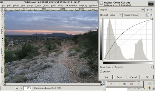 Curves tool. Make sure that Channel: is set to Value if you want to brighten the whole image. That should be the default.