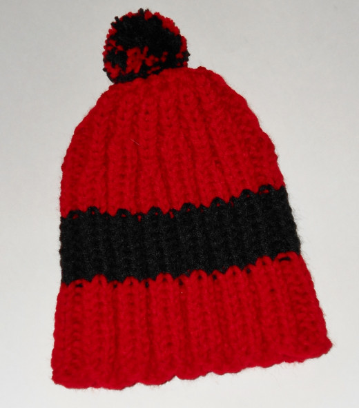 I knit the basic hat for $5 plus shipping.  An extra $5 gets a pom pom or reflective yarn.