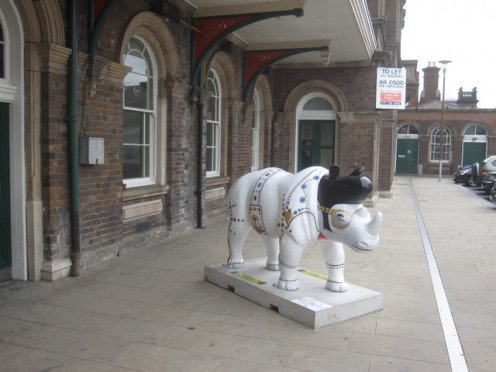 In the UK at Chester Station and thereabouts,  Rhino Mania was a street art project in 2010. This is Submission Number One -  Elvis Rhino. Artist: Martin Band.