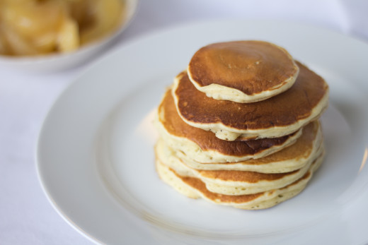 A fresh stack of apple pie pancakes, waiting to be topped with cinnamon apples.
