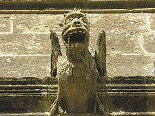 This is not a model for a Rolling Stone's album, it is a gargoyle found in ecclesiastical architecture.