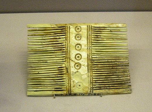 Ivory lice comb, circa 1200-1050 B.C. The circie with the dot at center is believed to represent the Dark Moon as a warning to never comb your hair on those days.