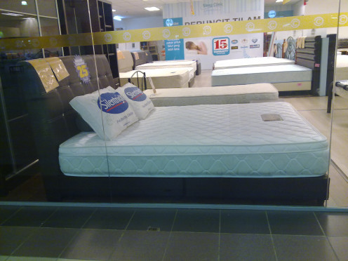 a comfy bed, looks inviting for kids