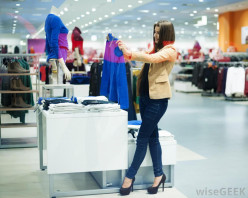 Woman taking her time in choosing clothes