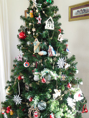 An eclectic Collection of Christmas Tree Ornaments Including Baby Jesus and Angels.