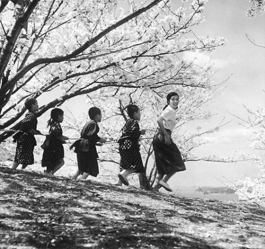 Miss Ōishi (Hideko Takamine) during a typical school day in Kinoshita's Twenty-Four Eyes (1954)