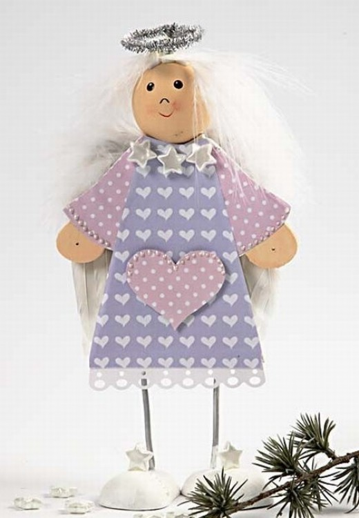 wooden angel doll with paper clothes
