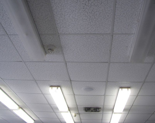Light Fixtures, a Speaker Grill, Smoke Detectors, and an Air Grill Installed on Ceiling