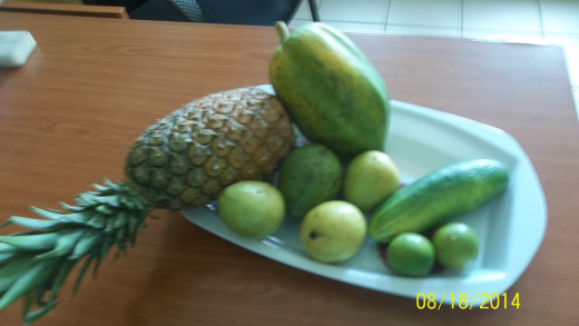 Pineapple, Papaya, Semi-Ripe Mangoes, Cucumber And Orange