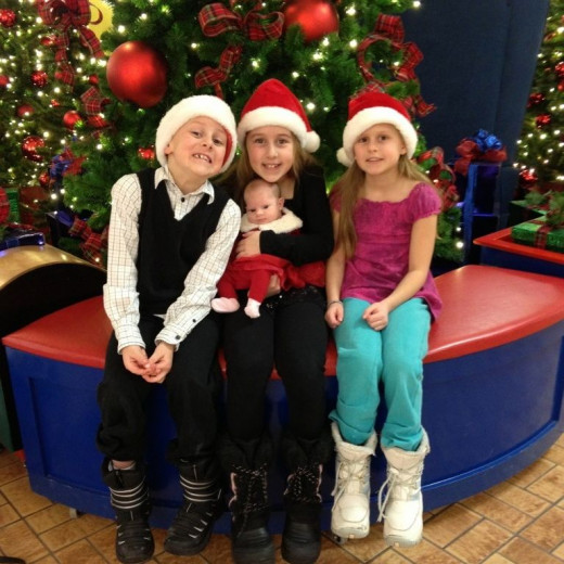 Kids in Santa hats at Christmas.