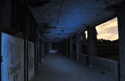 One of the many outdoor walkways at Waverly Hills Sanatorium. The ghost of a really beautiful woman with long red hair is seen near dawn and dusk here on this particular walk way.