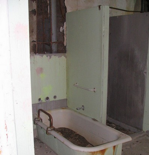 One of the many bathrooms at Waverly Hills Sanatorium. It is claimed that a nurse was known to drown people in this particular bathtub. Loud splashes and screams are said to be heard here in this particular bathroom quite often.