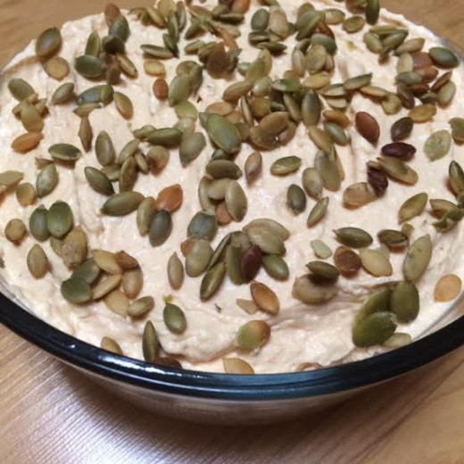 Savory pumpkin dip garnished with pumpkin seeds