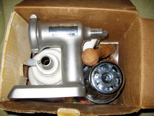 Here's the grinder in the attachment box. This is useful because all this stuff only goes in one way and it took me two years to figure out how after I took it out the first time and forgot.