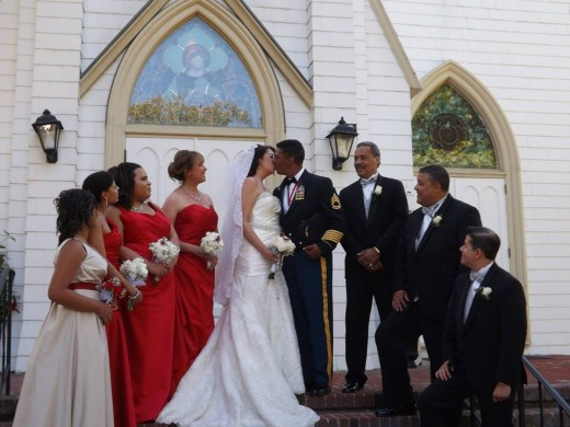 The bridal party looks on as my husband and I exchange a post-ceremony kiss in front of St. Andrew's Roman Catholic Church, 122 Division Street, Sag Harbor.