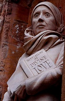 Statue of Julian on the front of Norwich Cathedral holding the Book of Revelations of Love
