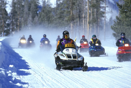 Snowmobiling in Yellowstone Park.