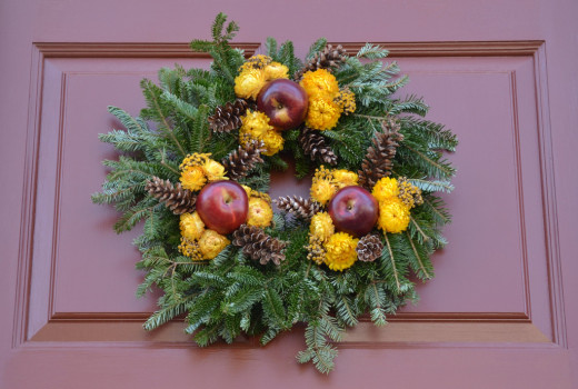 Wreaths made out of natural materials, such as apples and flowers, are beautiful as well as kind on the environment.