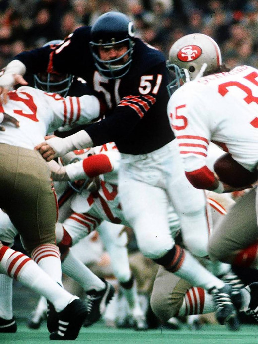 Nov. 19, 1972, Dick Butkus charges through the San Francisco 49'ers defensive line