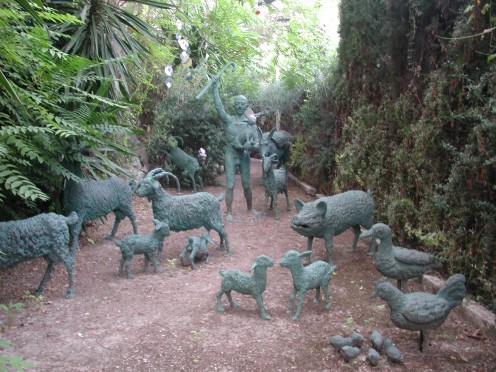Statues of Various Farmyard Animals with a Farmer