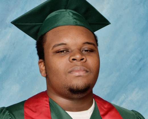Michael Brown after graduating high school with plans to go to college a week before being shot to death.