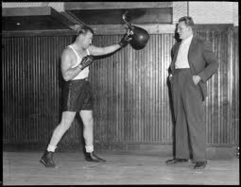 Jack Sharkey is seen in this archive photo hitting the speed bag. Sharkey beat legendary German boxer Max Schmeling for the heavyweight crown.