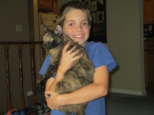 Grandson Ryan with his rescue cat, Missy