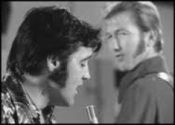 James Burton, background, one of the finest guitarists in the world was in Rick Nelson's show band