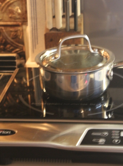 Stainless Steel Pot and Glass Cooktop