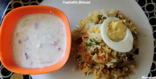 Biriyani With Egg Slice and Raita