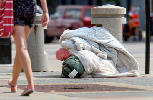 A homeless person's belongings at curb in front of the Madison Municipal Building.