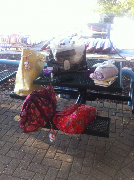 """Summer 2014- A few """"everyday provisions"""" at the bench near the boathouse I used to sleep at."""
