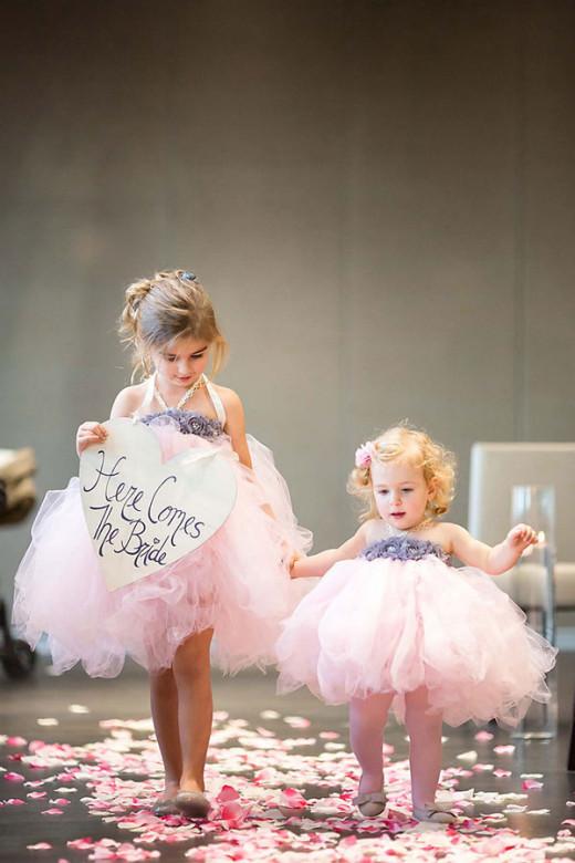Adorable flower girls wearing pink...