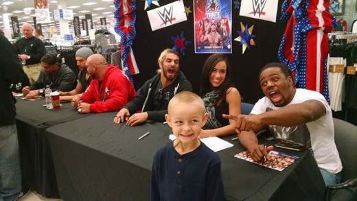 A boy and his first meet and greet with wrestler gods and goddess.