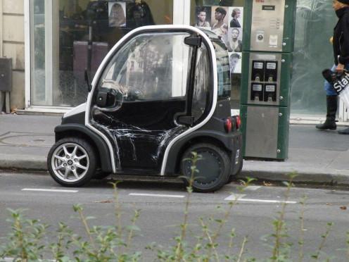 Electric car recharging in a street of Paris