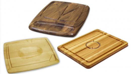 Left to right: J.K. Adams Maple Wood Double-Sided Pour Spout Carving Board in 3 Sizes, Gourmet Kansas City Carving Board in Acacia Wood, and Snow River Cherry Carving Board with Stainless Steel Gripping Ring and Juice Well.