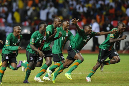 Isaac Chansa (8), Christopher Katongo (17) and Emmanuel Mayuka (20) among the players celebrating after Zambia defeated Ivory Coast  to win the Africa Cup of Nations in Libreville, Gabon.