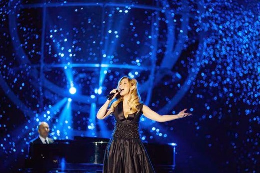 "Lara Fabian performing in the Russian TV special ""Song of the Year"" - December 2014. Dress by Igor Gulyaev."