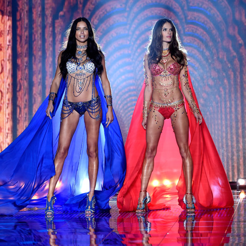 Models Adriana Lima and Alessandra Ambrosio wear the fantasy bras at the London 2014 VS Fashion Show.