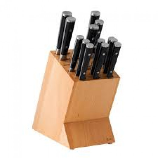 A Knife block keeps sharp knives away from kitchen users' way for safety.