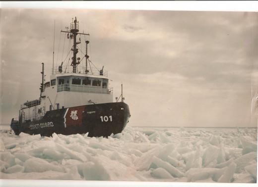 The U.S. Coast Guard Cutter Katmai Bay breaking ice in Whitefish Bay.