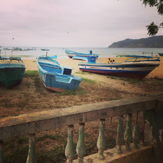 Pretty beach town of Puerto Lopez with painted boats on the mid-coast region of Ecuador.