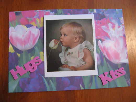 I added the picture on a mat and used a floral card for the background. The words are stick-on foam letters.