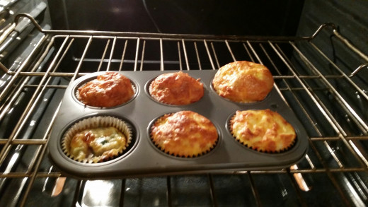 Cooked Omelette Muffins With Cheese Added (on 5 out of 6 muffins pictured)